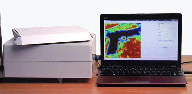 Terahertz image of a hand-gun in a box
